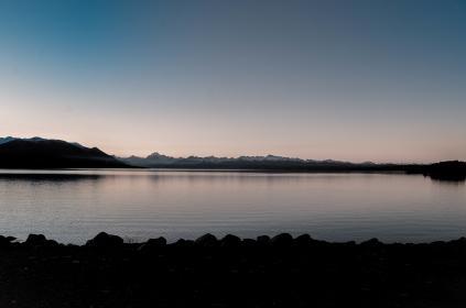 nature, landscape, mountains, coast, shore, cliff, rocks, water, ocean, sea, waves, ripples, sky, clouds, horizon, shadows, gradient, blue, gray, black, silhouette