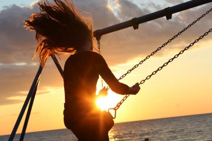 sunlight, sunset, girl, hair, people, wind, seesaw, play, relax, beach, sea, water, nature, clouds, sky, steel