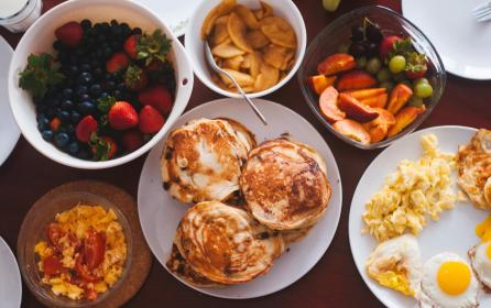 food, eat, breakfast, eggs, sunny, side, up, scrambled, yolk, pancakes, fruits, grapes, strawberries, spread, plates, forks, cups, mugs, glasses, bowls, flatlay, still, bokeh
