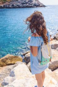 coast, ocean, sea, water, nature, rocks, blue, girl, dress, bag, hair, wind, people
