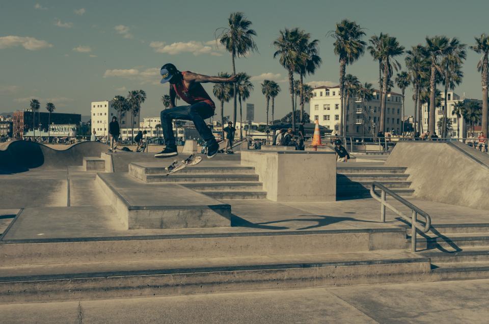 skater, skateboard, skate park, steps, railing, sunny, palmtrees, pylon, tricks, kickflip, jump, kid, boy, ramp, concrete, street