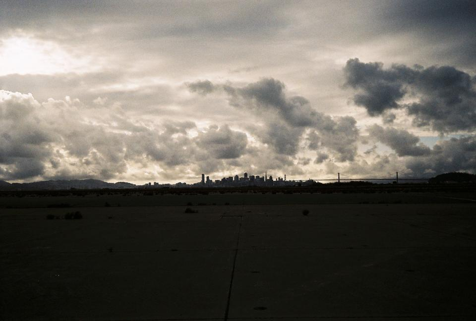sky, clouds, dark, dusk, silhouette, shadow, city, buildings, skyline, field