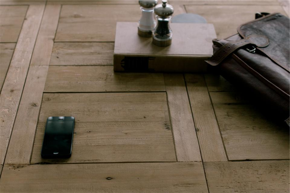 wood, table, iphone, cell, mobile, technology, leather, briefcase, bag, salt, pepper, shakers, book