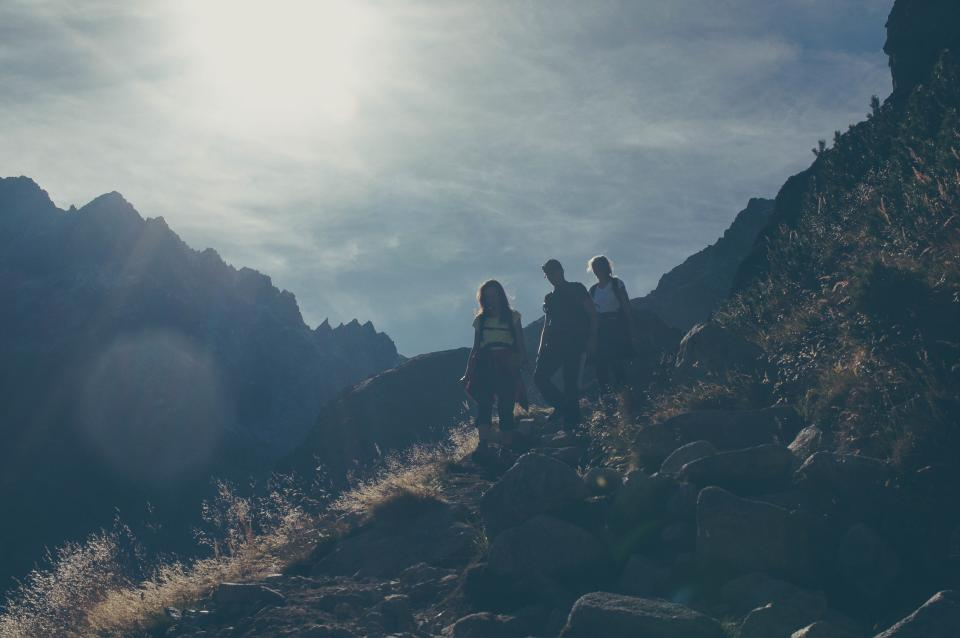 people, hiking, trekking, mountains, hills, cliffs, fitness, exercise, sun rays, sunshine, clouds, outdoors, nature, rocks