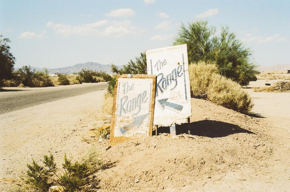 range, signs, road, sand, sunny, bushes, arrows
