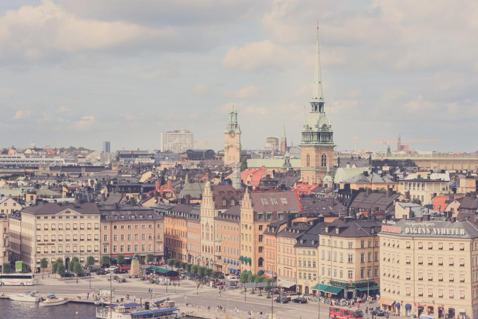 city, buildings, roads, street, water, boats, skyline, view, stockholm, sweden, shops, stores, people, signs, busses, square, towers