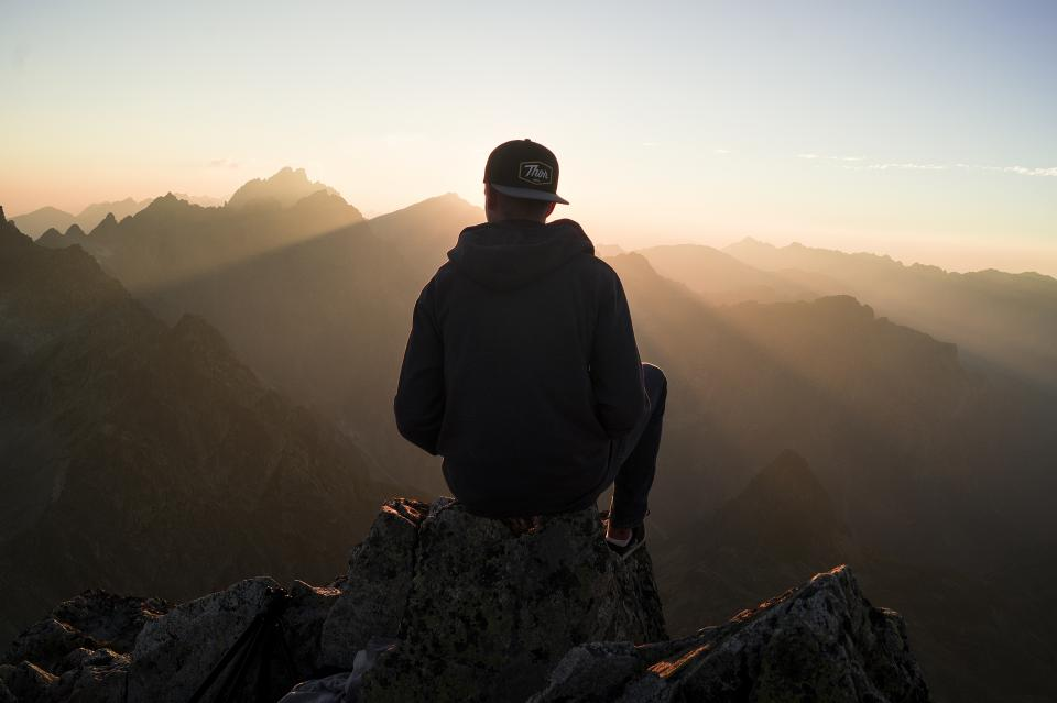 guy, man, male, people, back, contemplate, sit, nature, mountains, rocks, travel, trek, hike, climb, summit, peaks, fog, sky, horizon, gradient