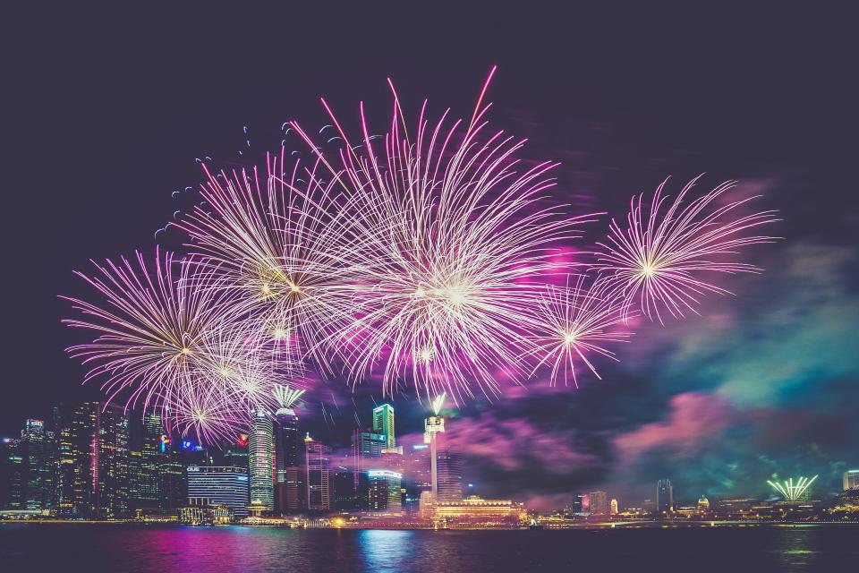 fireworks, lights, celebration, sky, night, dark, evening, cityscape, buildings, high rises, skyscrapers, urban, city, water, clouds