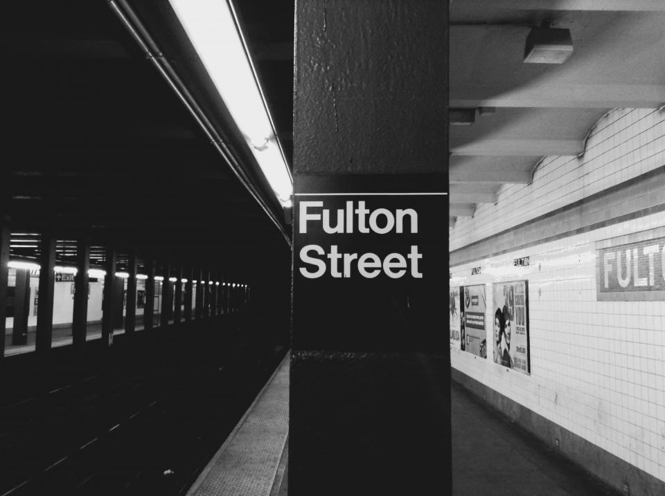Fulton Street, NYC, subway, station, transportation, platform, urban, New York City, black and white