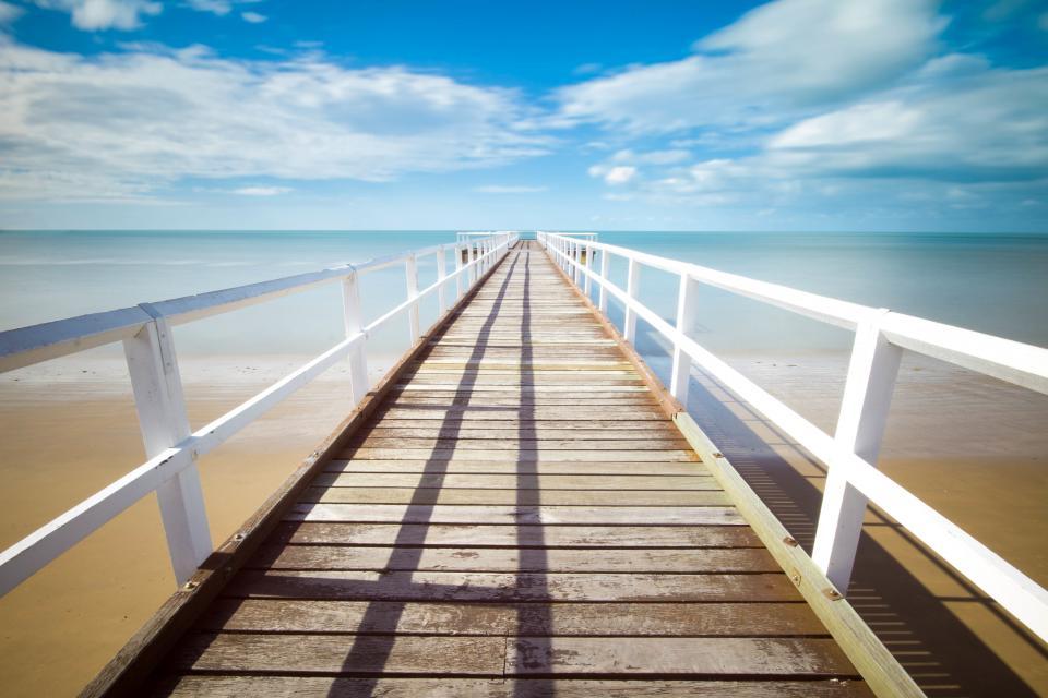 beach, sand, tropical, dock, pier, railing, wood, ocean, sea, water, sky, clouds