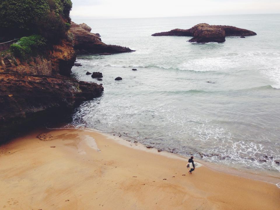 beach, sand, surfer, surboard, surfing, shore, coast, water, waves, sea, ocean, rocks, cliffs