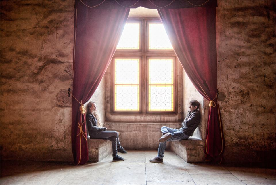 guy, girl, people, sitting, talking, conversation, window, sunlight, curtains, drapes, concrete, walls