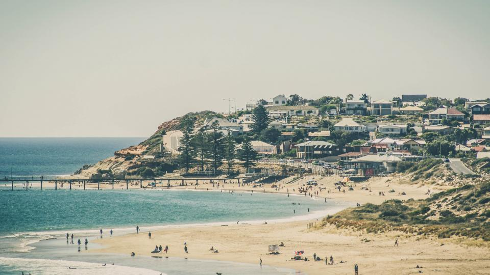 beach, shore, coast, sand, people, summer, sunshine, sunny, ocean, sea, houses, city, town, landscape