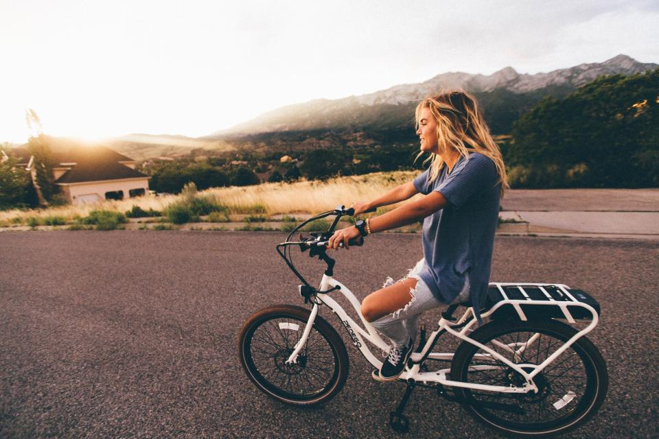 girl, woman, bike, bicycle, blonde, people, lifestyle, road, model, beautiful, pretty, landscape, outdoors, sunset, mountains, pavement, jeans