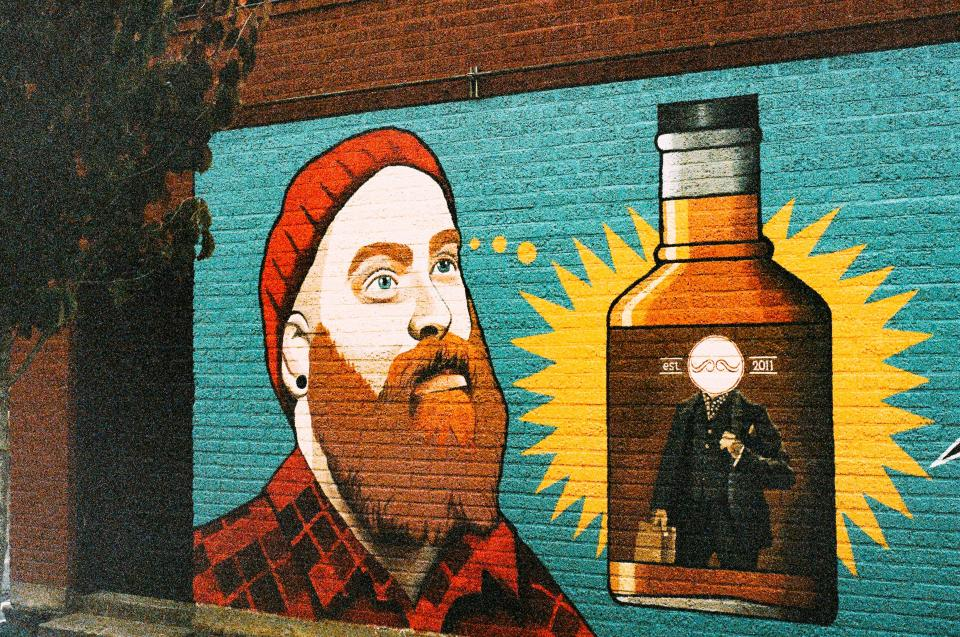 wall, paint, graffiti, man, orange, beard, hat, toque, plaid, hipster, alcohol, booze, whiskey
