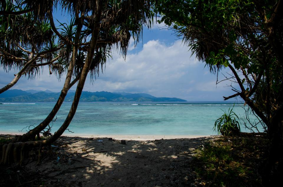 beach, sand, tropical, sea, ocean, water, vacation, trees, mountains, sky, clouds