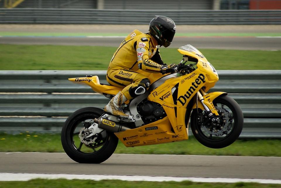 motorcycle, bike, racing, racer, helmet, wheelie, race track, guard rail