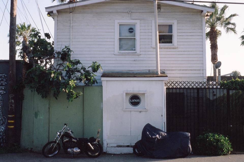 linus, bike, motorcycle, house, palm trees, siding, windows