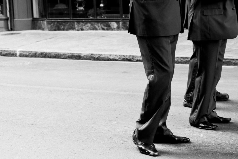 men, suites, pants, dress shoes, street, sidewalk, pavement, black and white