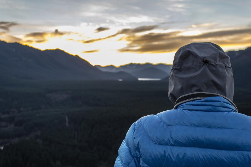 jacket, hood, mountains, hills, valleys, field, sunset, sky, clouds, cold, outdoors, nature, landscape, person