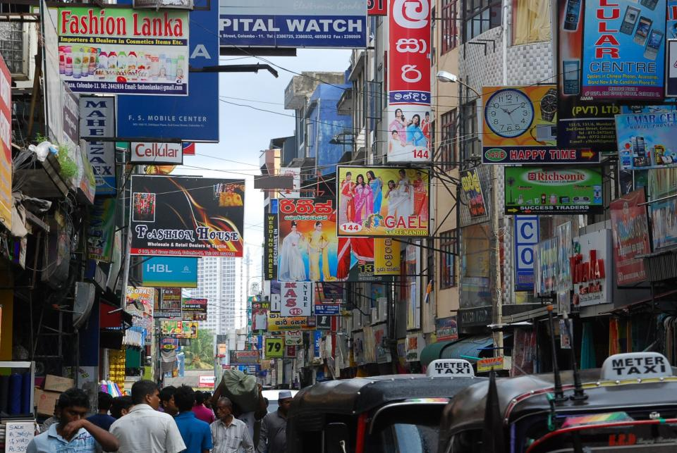 India, Indians, people, city, streets, traffic, taxis, cars, crowd, pedestrians, signs, stores, shops, buildings