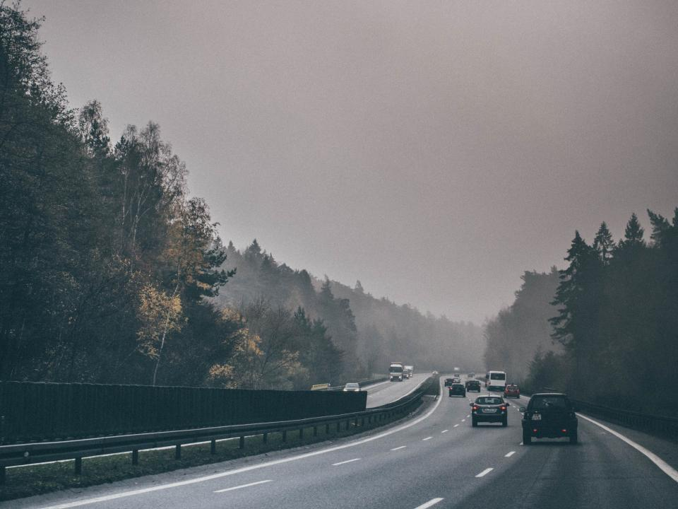 highway, road, cars, driving, trees, grey, sky