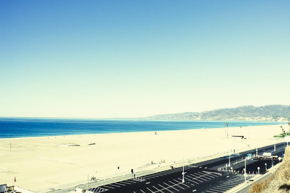 beach, sand, water, ocean, blue, sky, sunshine, boardwalk, parking lot, mountains, view