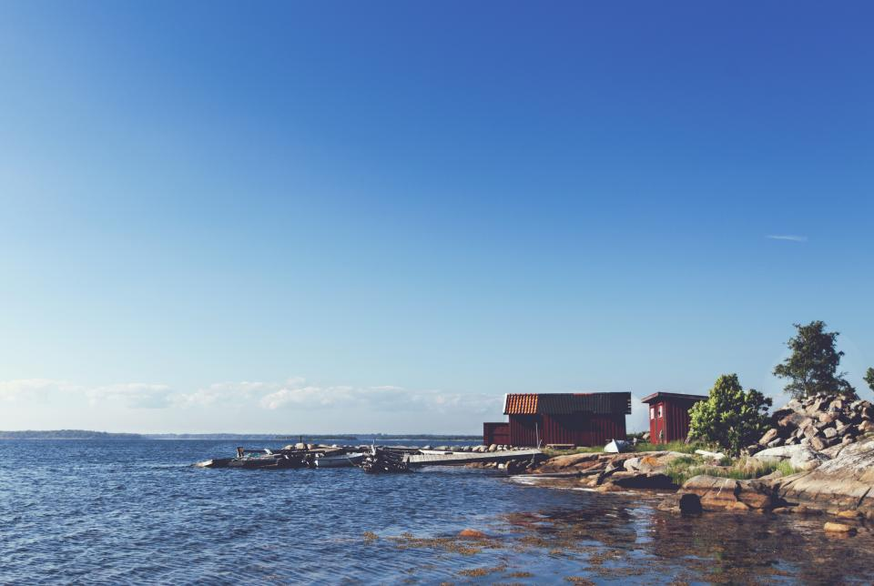 lake, water, docks, boats, rocks, sunshine, sunny, summer, blue, sky, cottage, shed