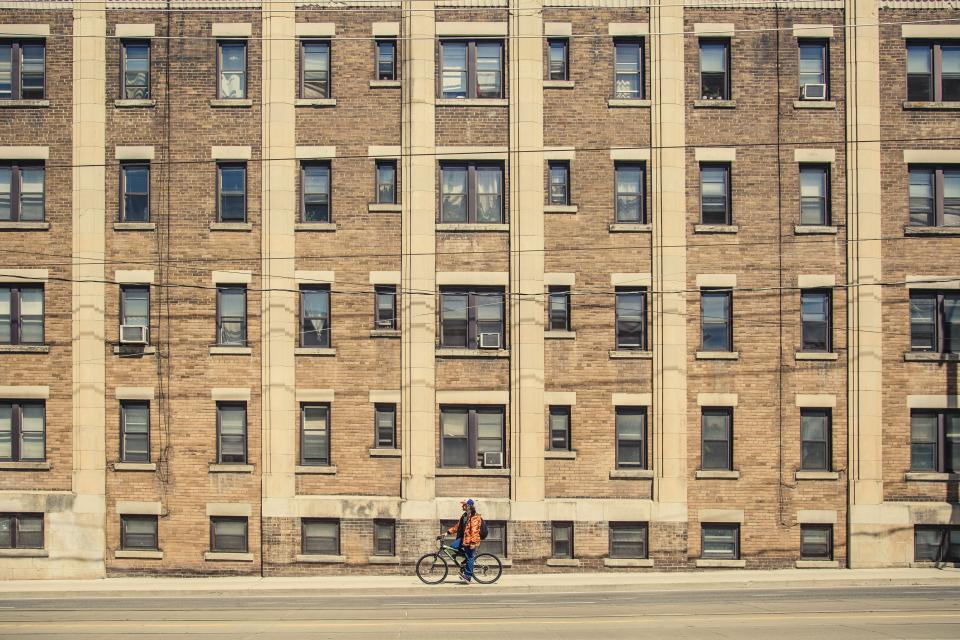 building, architecture, windows, apartment, city, street, road, sidewalk, bike, bicycle, people, man, guy, lifestyle