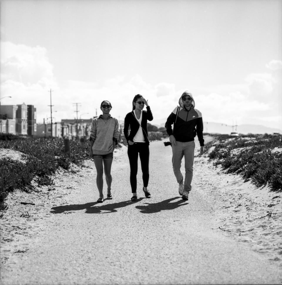 people, walking, guy, girls, women, happy, smiling, photographer, trail, path, sand, black and white, lifestyle