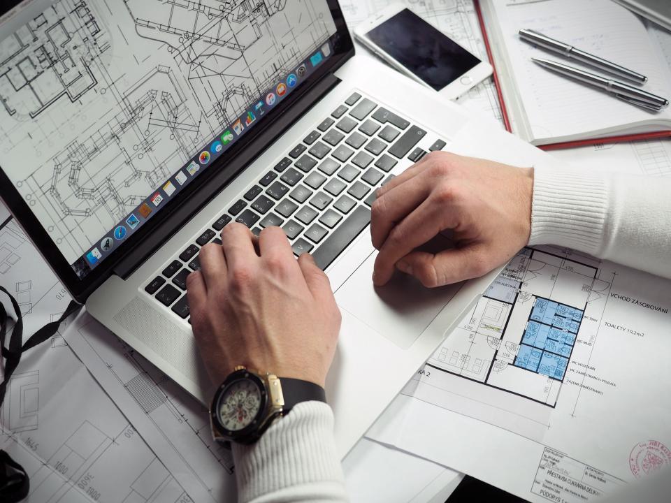 office, work, business, workspace, table, desk, gadgets, macbook, laptop, computer, blueprints, drafts, floor, house, plans, layouts, autocad, corel, notebook, journal, pens, lanyard, man, male, hands, wrist, watch, type, design