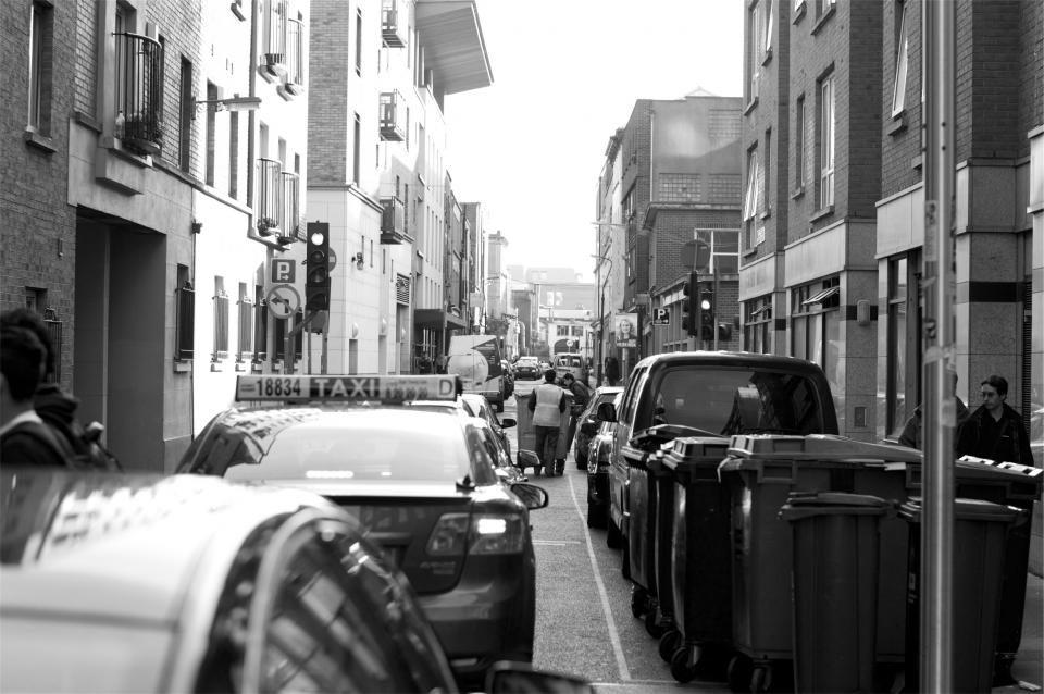 cars, trucks, taxi, street, road, buildings, city, urban, people, black and white