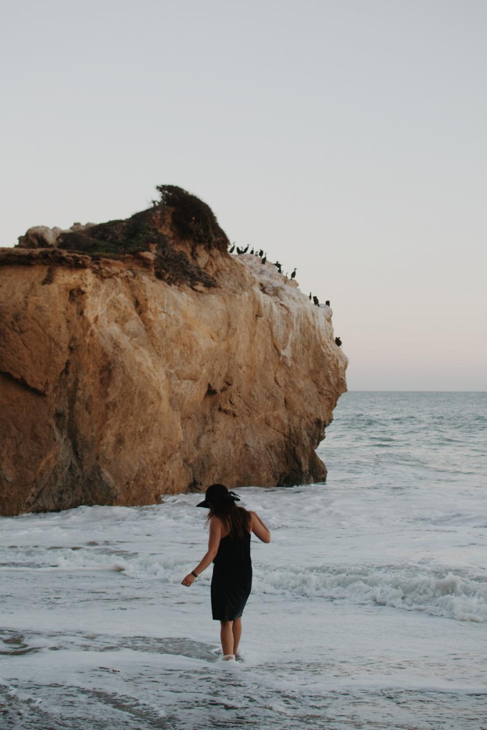 beach, water, waves, girl, woman, hat, dress, ocean, sea, cliffs, rocks, coast, birds, people