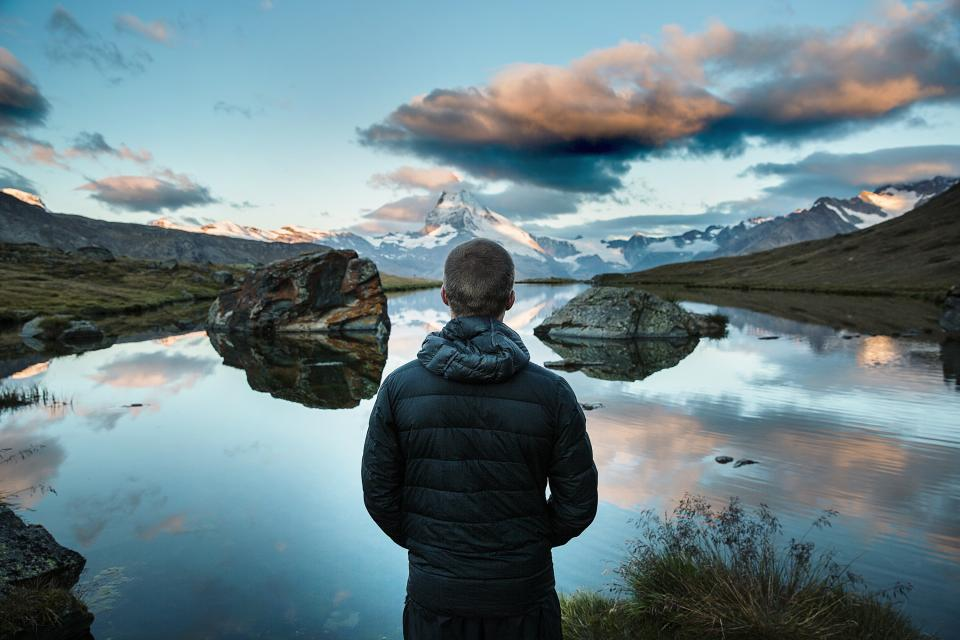 guy, man, people, landscape, mountains, nature, river, water, reflection, sky, clouds, hills, valleys, jacket, coat, adventure, outdoors