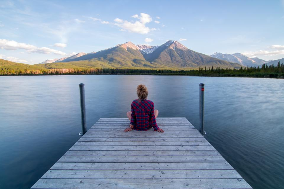 woman, girl, lady, people, back, contemplate, sit, style, checkered, view, nature, water, lake, surface, mountains, peaks, trees, lush, vegetation, sky, clouds, horizon, wood, dock, panels