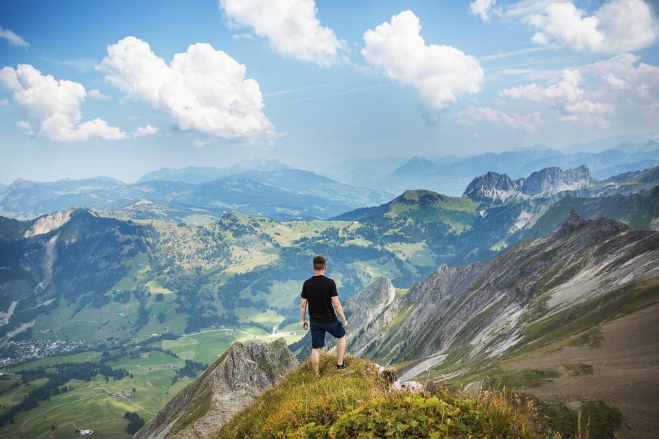 hiking, trekking, mountains, cliffs, valleys, hills, fields, nature, landscape, guy, man, people, shorts, tshirt, sky, clouds, adventure, outdoors