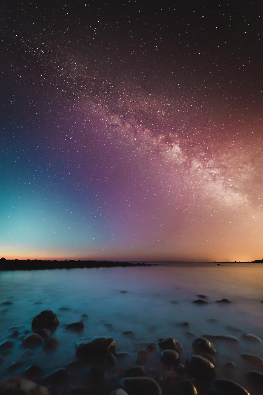 nature, landscape, water, ocean, sea, still, calm, surface, rocks, islands, reflection, sky, clouds, sky, stars, constellations, falling, universe, galaxy, beautiful, silhouette, gradient, light, leaks, blue, purple, yellow