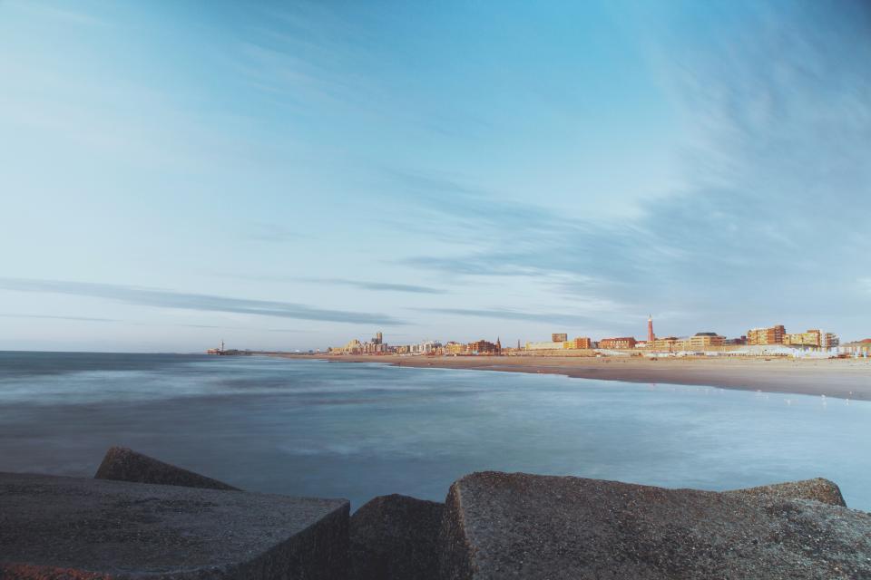 landscape, beach, sand, shore, ocean, sea, rocks, blue, sky, city, town, clouds, nature