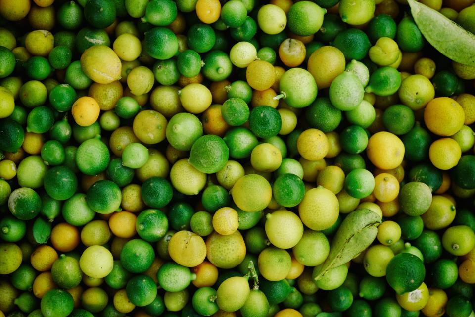 food, fruits, lemon, lime, citrus, group, pile, spheres, leaves, green, yellow,