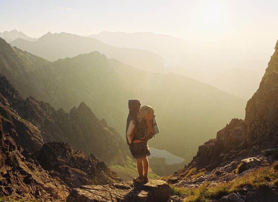 sky, sun, mountains, cliff, hiker, hiking, knapsack, backpack, shorts, hoodie, nomad, peak