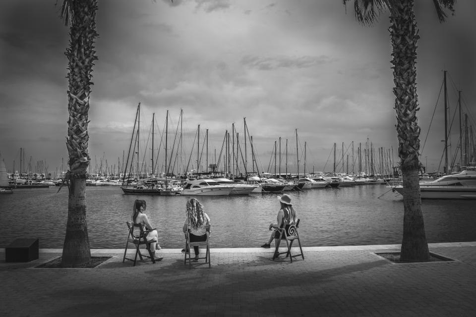 girls, people, woman, women, sailboats, boats, dock, marina, harbor, harbour, sky, clouds, cloudy, black and white