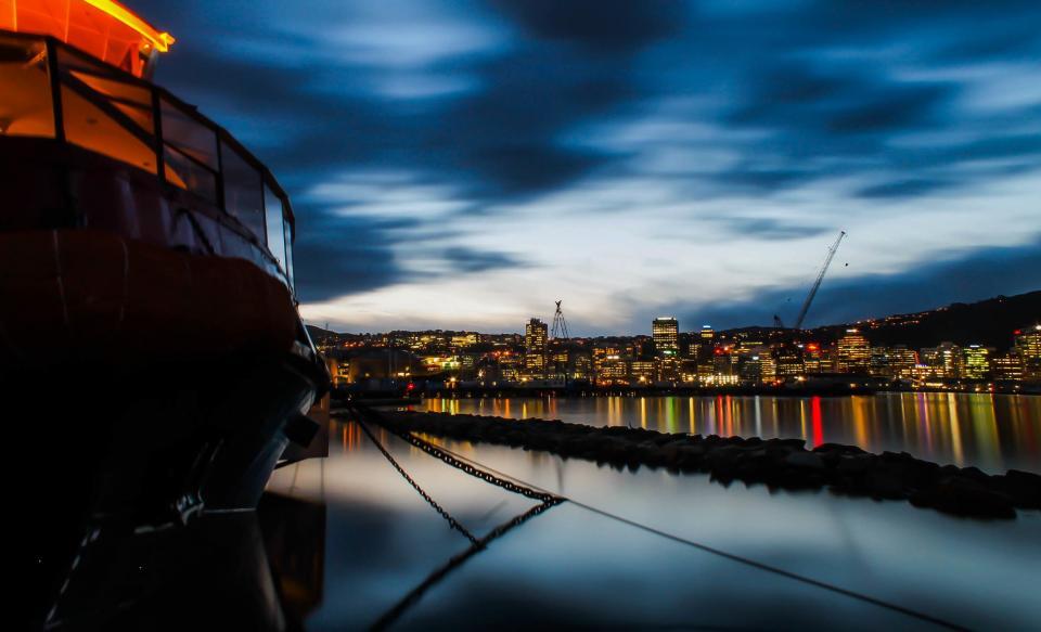 boat, ship, anchor, buildings, skyline, night, dark, evening, lights, sky, clouds