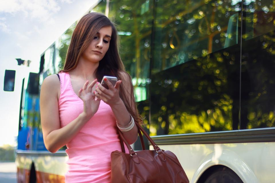 young, girl, long hair, brunette, pink, tank top, cell phone, mobile, purse, bus, texting, iphone, technology