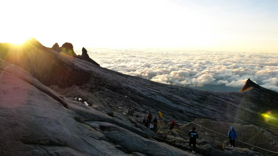 sky, clouds, sunlight, sunset, hiking, hikers, people, mountains, peaks, cliffs, trek, trail, cold, jackets
