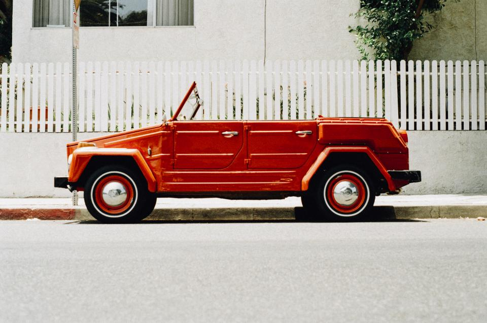 red, car, convertible, wheels, tires, street, sidewalk, white, fence, parked, house