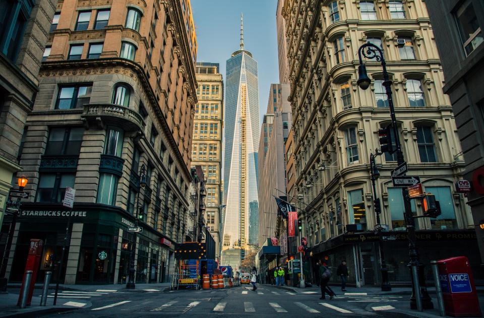 city, buildings, stores, shops, starbucks, towers, skyscrapers, road, street, crossing, people, pedestrians, windows, lamp posts, sidewalk, construction