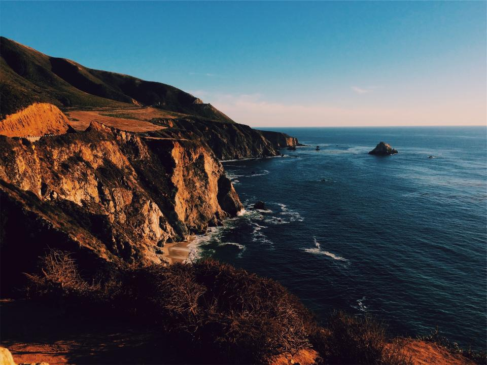 sunset, mountains, cliffs, coast, ocean, sea, waves, water, blue, sky, landscape