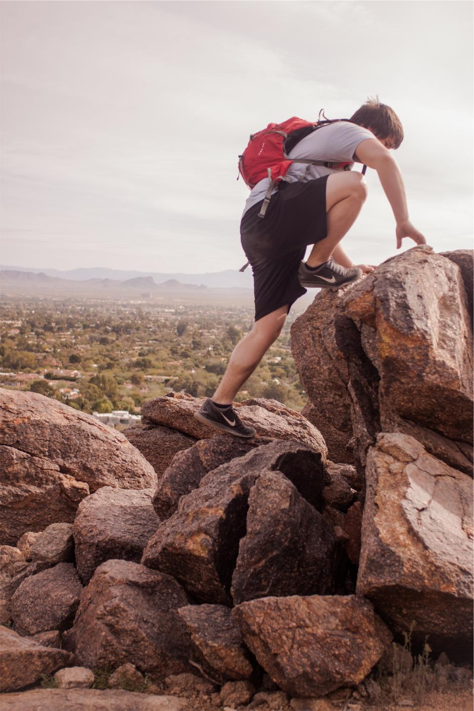 hiking, hiker, young, guy, boy, people, rocks, boulders, backpack, knapsack, shorts, tshirt, fitness, nike, shoes