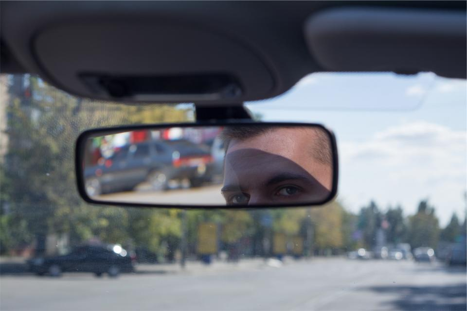 rearview mirror, windshield, car, driving, road, man, guy, eyes