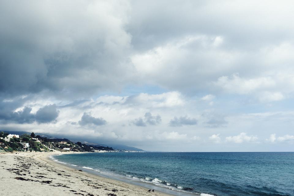 beach, sand, water, waves, ocean, sea, storm, clouds, sky, mountains